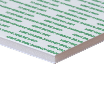White Foam Board With Self-Stick Repositionable Adhesive with green writing